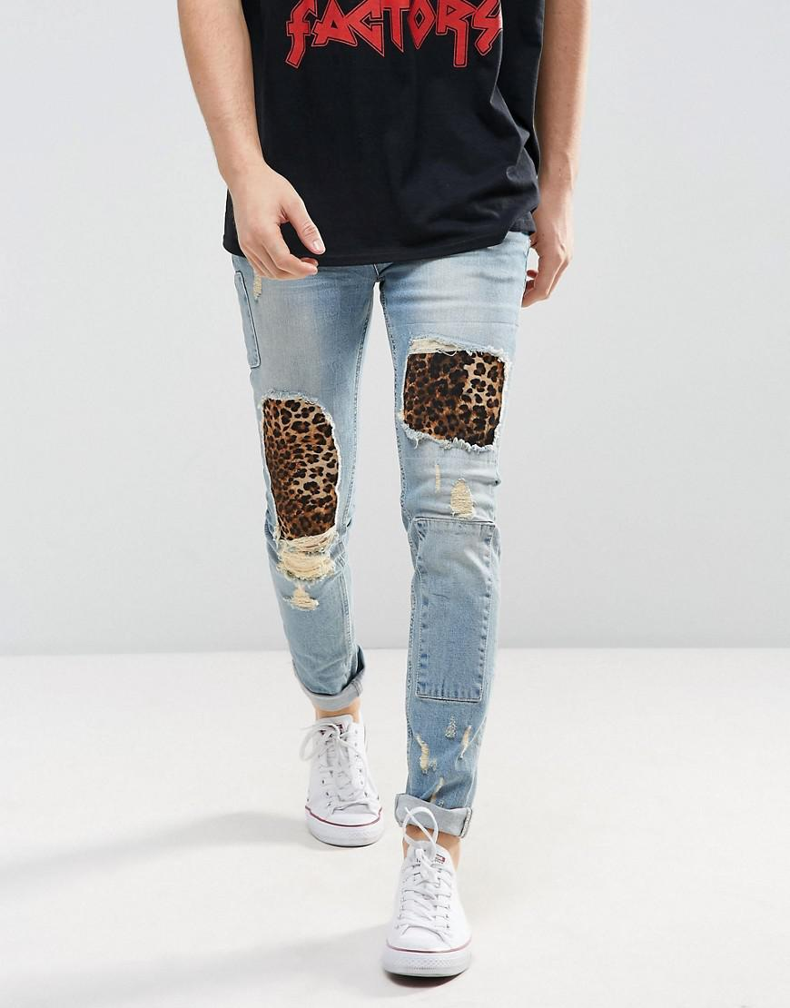 asos skinny jeans in light wash blue with punk patches and rips