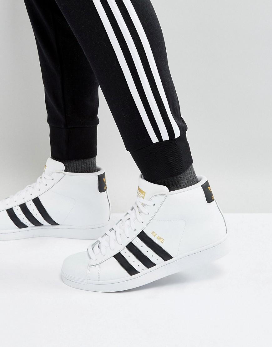 grande vente d96af c1b7a Adidas Originals Pro Model Mid Sneakers In White S85956