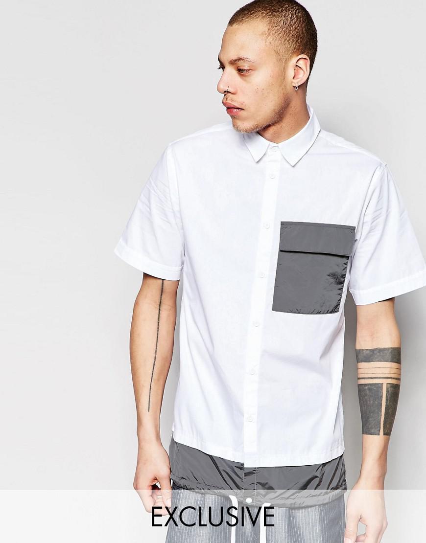 black eye rags short sleeve shirt with contrast pocket and drawstring hem