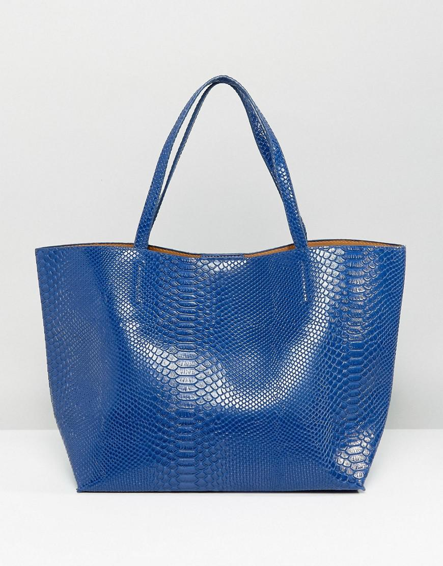 glamorous faux python tote bag in blue