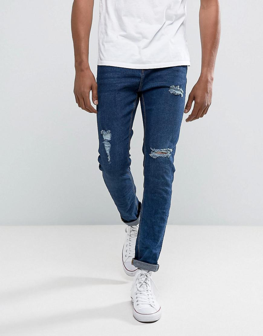 bershka skinny jeans with rips in mid wash