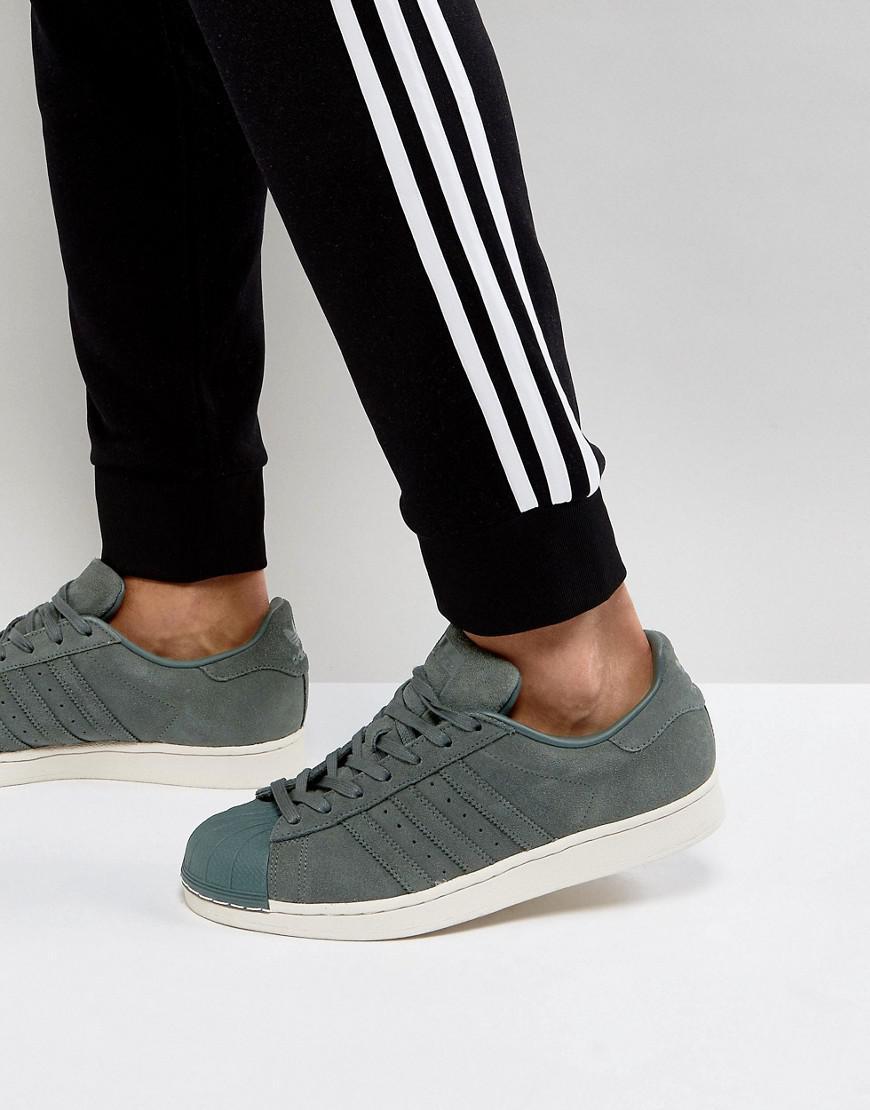 adidas originals superstar sneakers in green bz0200