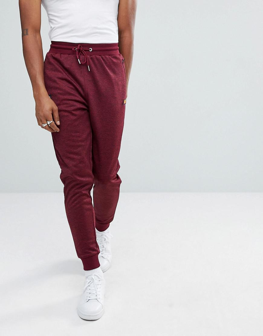 ellesse poly tricot track joggers in burgundy