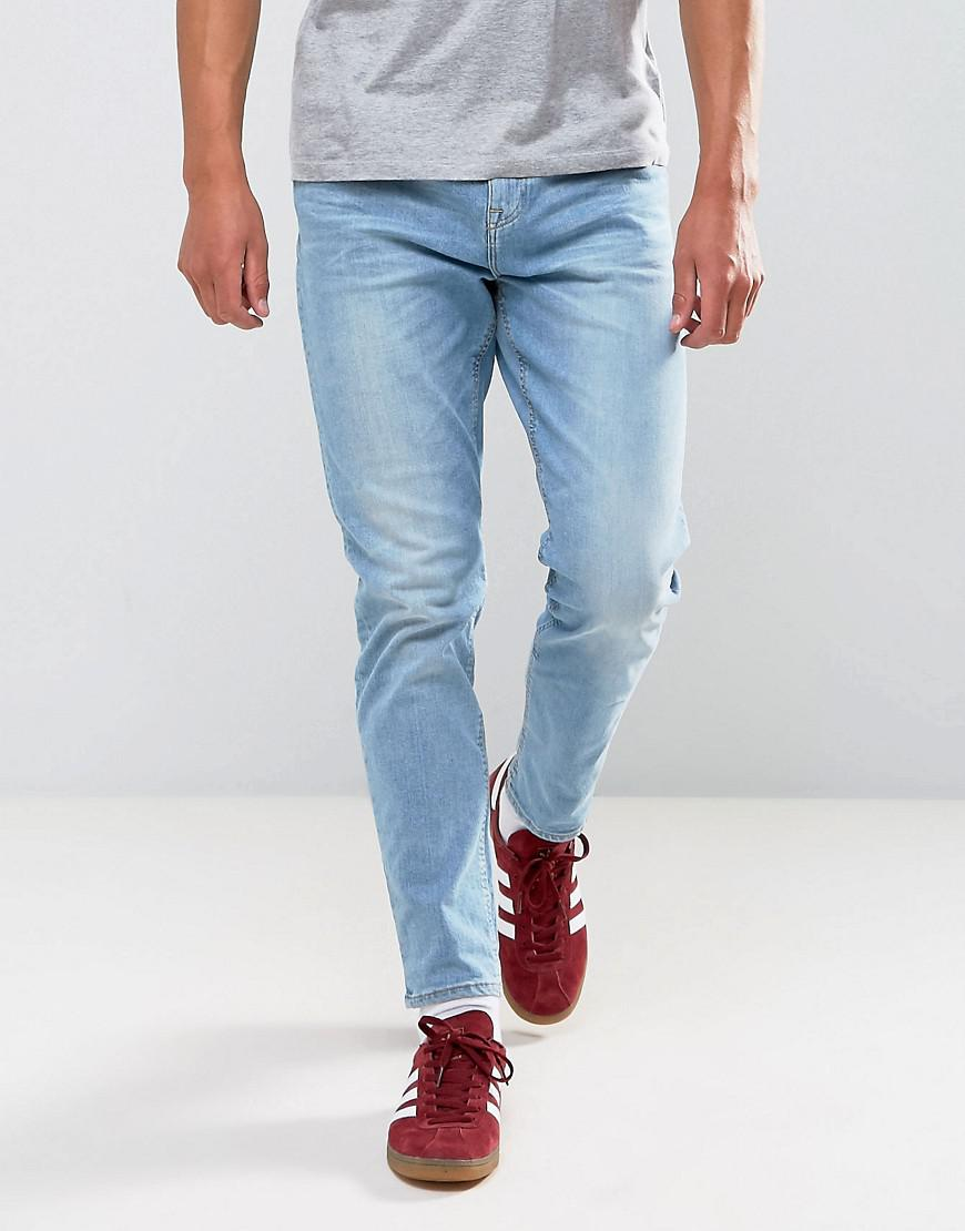 fashion clothing asos tapered jeans in 125oz in light wash blue modysta. Black Bedroom Furniture Sets. Home Design Ideas