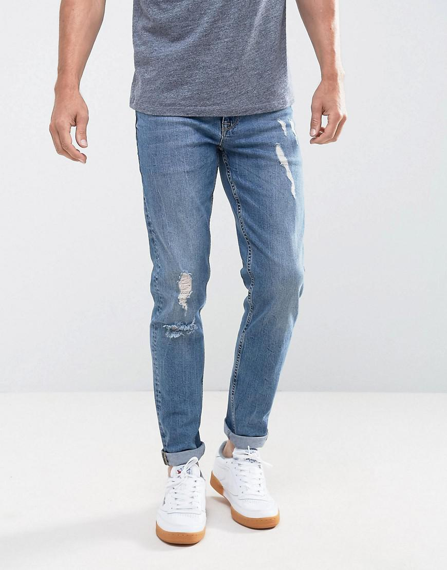 asos stretch slim jeans in 12.5oz mid wash blue with rips