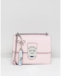 aldo cross body bag with silver hardwear in pink