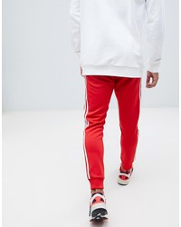 adidas originals superstar joggers in red dh5837