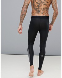 reebok training jacquard knitted compression tights in black cy4893