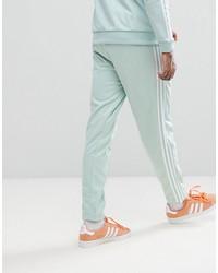 adidas originals adicolor beckenbauer joggers in skinny fit in blue cw1272