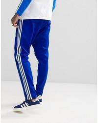 adidas originals adicolor beckenbauer joggers in skinny fit in blue cw1271