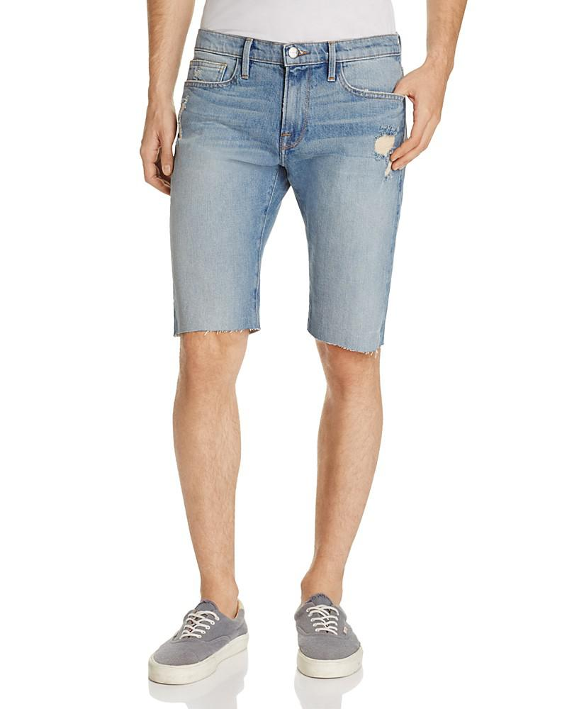 frame l'homme denim cutoff shorts in saratoga