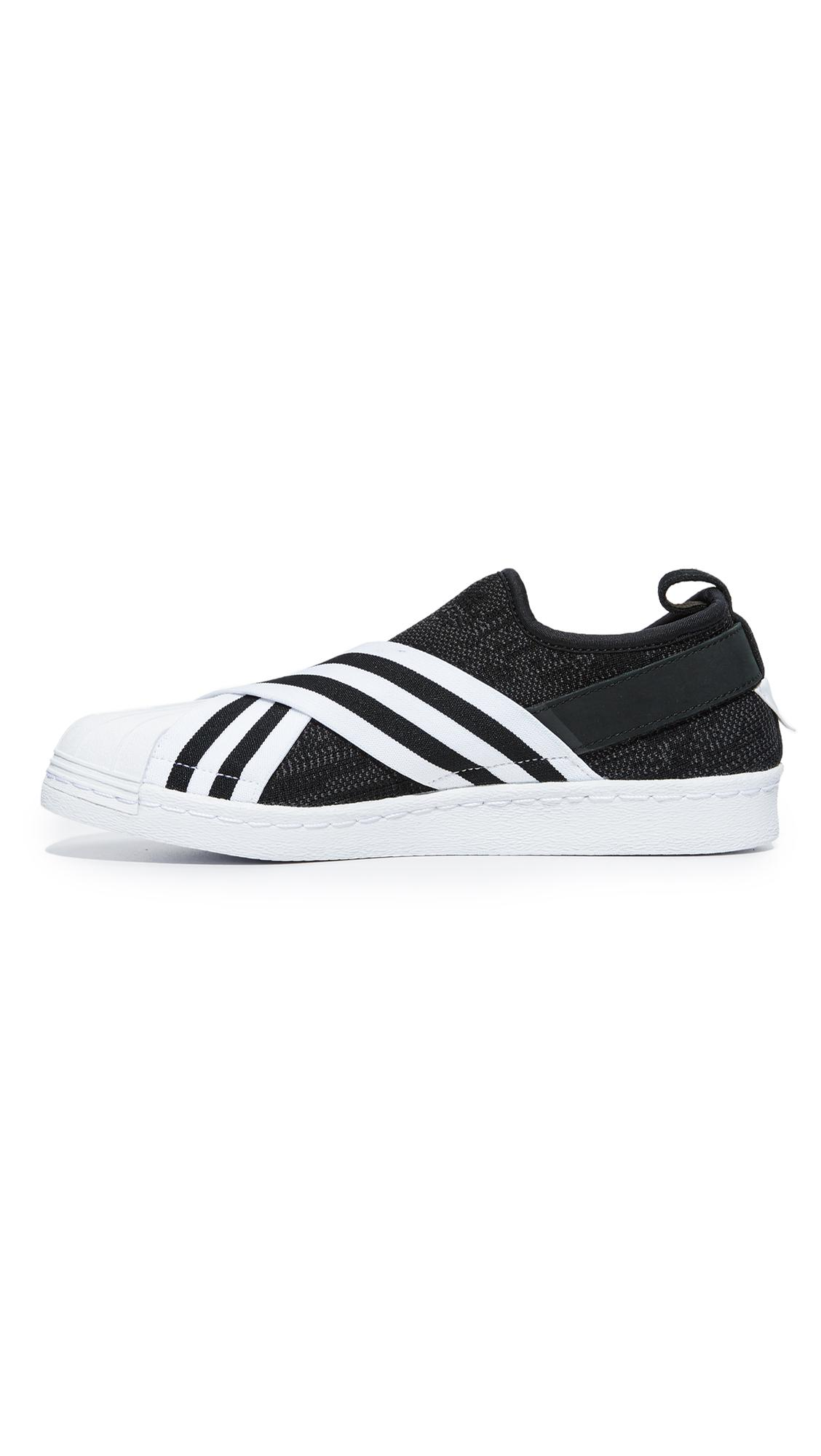 60771b752fd9 white mountaineering x adidas originals superstar sneakers black