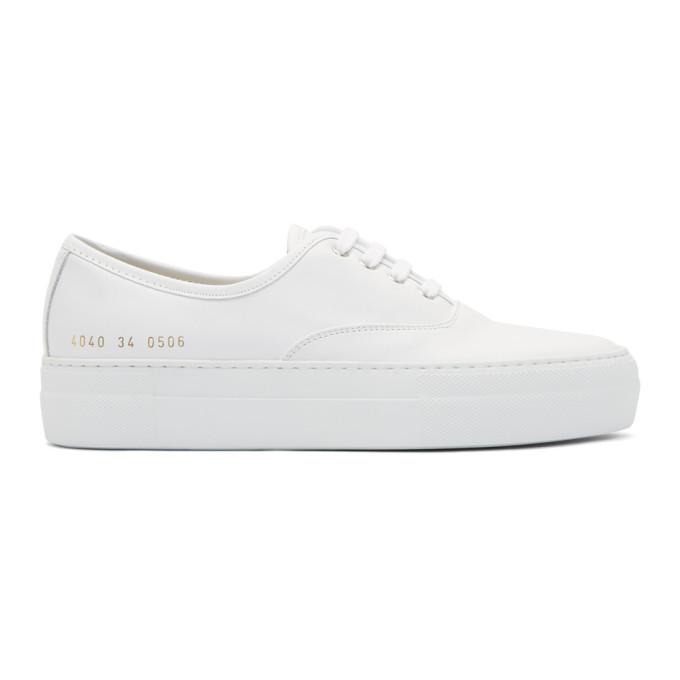 white tournament four hole sneakers